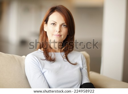 Close-up portrait of beautiful business woman sitting at home.