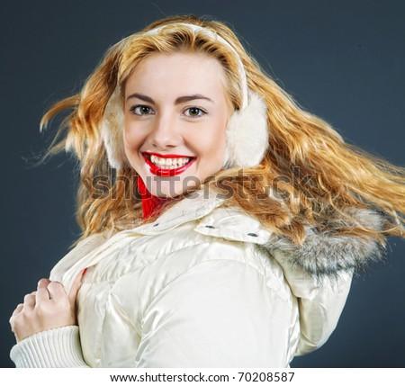 Close-up portrait of beautiful fashion girl wearing warm winter clothing - stock photo