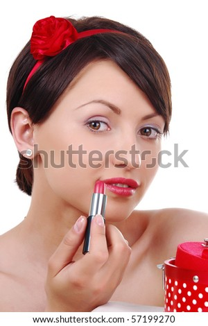 close up portrait of beautiful girl doing make up - stock photo