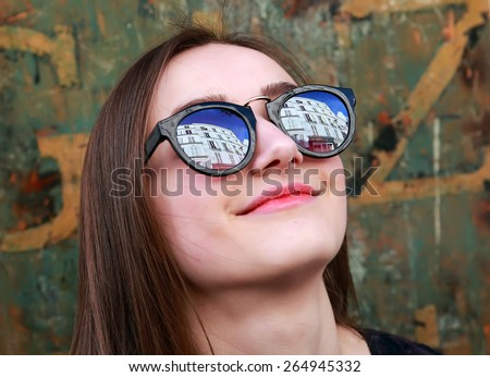 Close-up portrait of beautiful girl on vintage background - stock photo