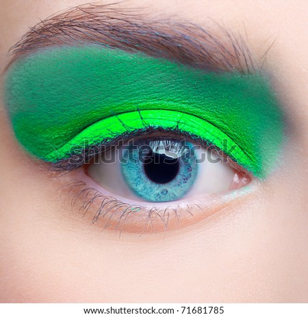 close-up portrait of beautiful girl's eye-zone make-up with blue eye shadows - stock photo