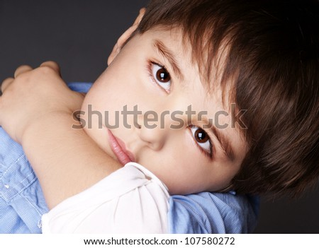 Close-up portrait of beautiful little boy with attentive look, studio shot - stock photo