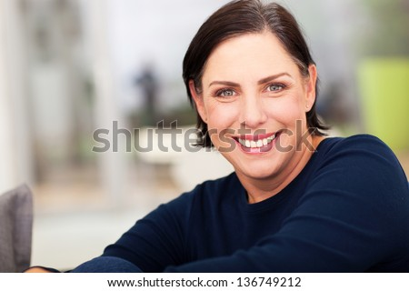 close up portrait of beautiful mature woman - stock photo