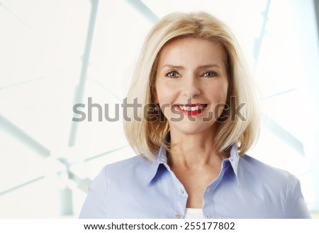 Close-up portrait of beautiful mature woman smiling. - stock photo
