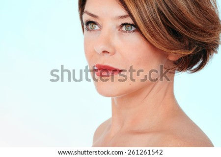 Close up portrait of beautiful middle aged woman looking aside - stock photo