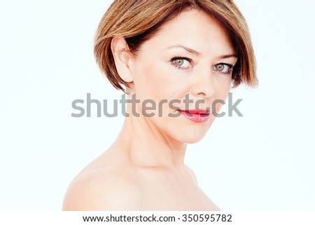 Close up portrait of beautiful middle aged woman with short brown hair, red lips and fresh makeup over white background - beauty concept - stock photo