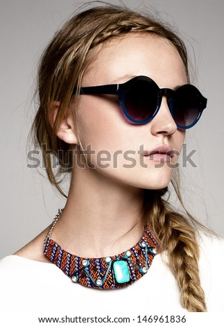 close-up portrait of beautiful model with sunglasses - stock photo