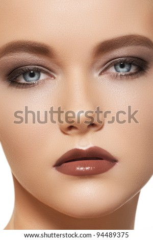 Close-up portrait of beautiful model woman with sexy fashion evening make-up, brown gloss lips makeup - stock photo