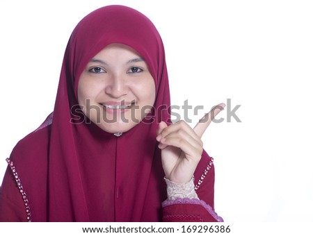 Close-up portrait of Beautiful Muslim Girl point her finger. Over white background  - stock photo