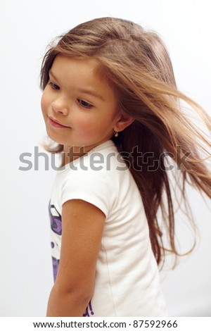 close-up portrait of beautiful small girl with streaming hair - stock photo