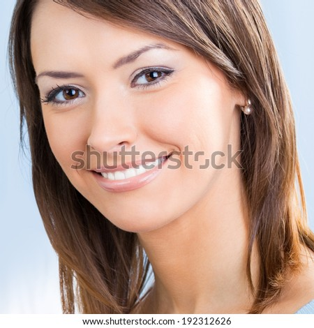 Close up portrait of beautiful smiling young woman - stock photo