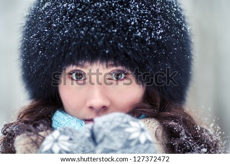 Close-up portrait of beautiful winter woman