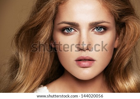 Close-up portrait of beautiful woman - stock photo