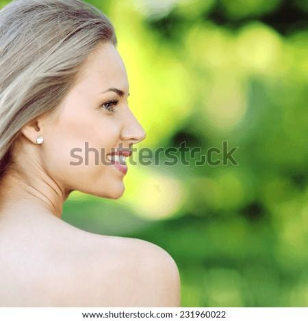 Close up portrait of beautiful woman face - stock photo