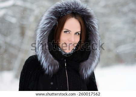 Close up portrait of beautiful woman in winter forest