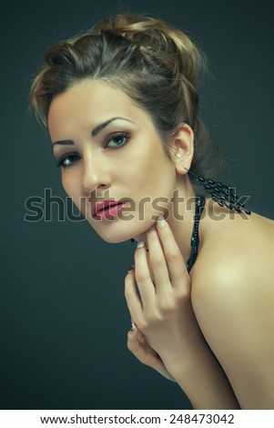 Close-up portrait of beautiful woman shot in a studio