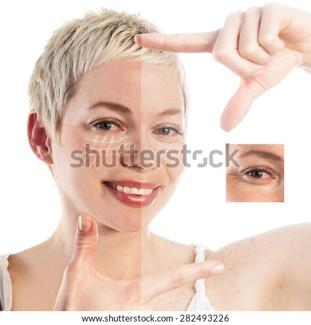 Close-up portrait of beautiful woman with arrows on her face, looking at camera through finger frame, beauty concept