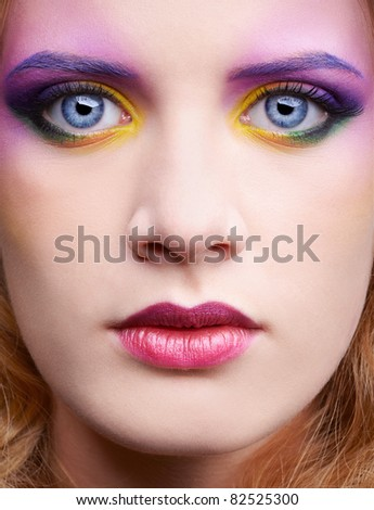 close up portrait of beautiful woman with colorful make-up - stock photo