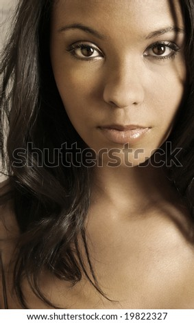 Close up portrait of beautiful young African-American girl - stock photo