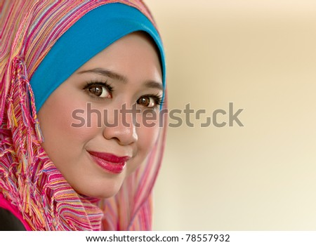 Close-up portrait of beautiful young Asian Muslim woman - stock photo