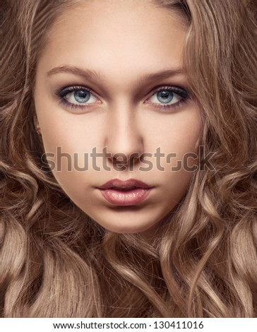 close-up portrait of beautiful young girl with brown hair and perfect skiin - stock photo
