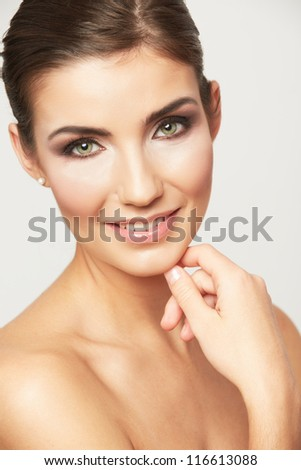 Close up portrait of beautiful young woman face. Isolated on white background. Portrait of a female model. Hair style comb back.