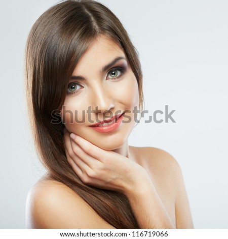Close up portrait of beautiful young woman face. Isolated on white background. Portrait of a female model.