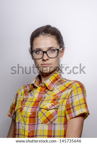 Close-up portrait of beautiful young woman in glasses. On white background .