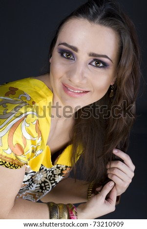 close up portrait of beautiful young woman in yellow dress