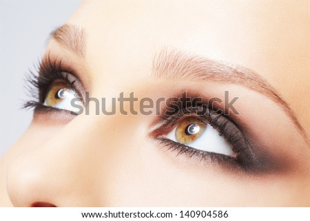 close-up portrait of beautiful young woman's eye zone make-up - stock photo