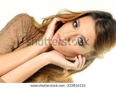 close up portrait of beautiful young woman wearing perfect evening make up and framing her face with her hands  isolated on White background - stock photo