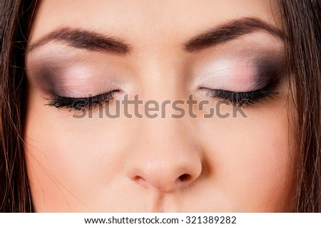 Close-up portrait of beautiful young woman with make-up - stock photo