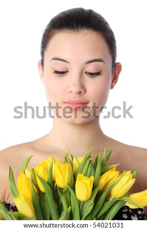 Close-up portrait of beautiful young woman with yellow tulips, isolated over white background