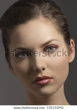 close-up portrait of beauty girl with green eyes, red glossy make-up ...