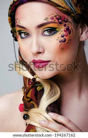 close up portrait of beauty woman with face art - stock photo