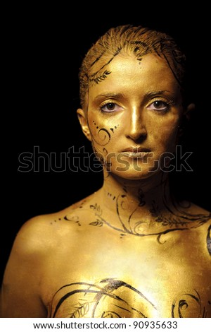 close up portrait of beauty woman with golden skin, isolated on black