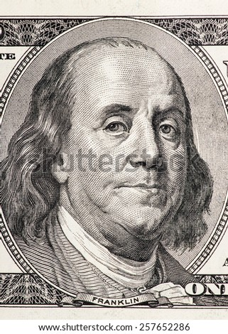 Close-up portrait of Benjamin Franklin in front of the one hundred US dollar bill - stock photo