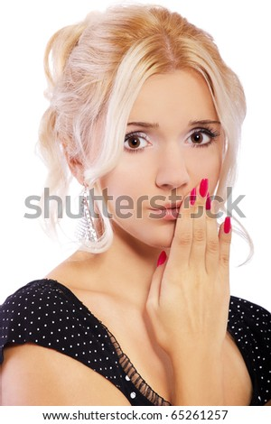 close-up portrait of blonde girl with manicured fingers on white