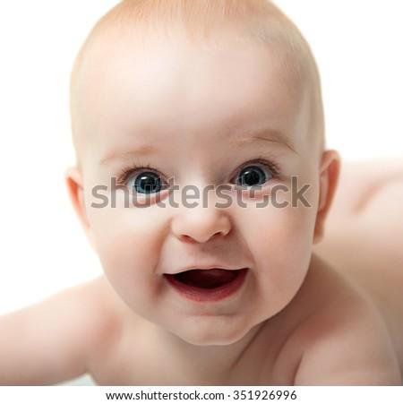 close up portrait of blue eyed baby boy isolated on white background - stock photo