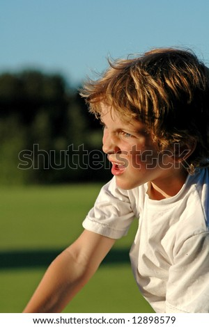 close-up portrait of boy playing sport at park - stock photo
