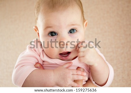 Close-up portrait of breastfed child with emotions and gaze