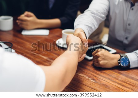 Close up portrait of businessmen shaking hands - stock photo