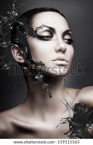 close up portrait of calm brunette woman black splash