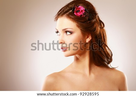 Close-up portrait of caucasian young woman with beautiful eyes isolated on white background.Side view.