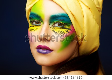 Close-up portrait of Caucasian young woman with face art glamour make-up. - stock photo