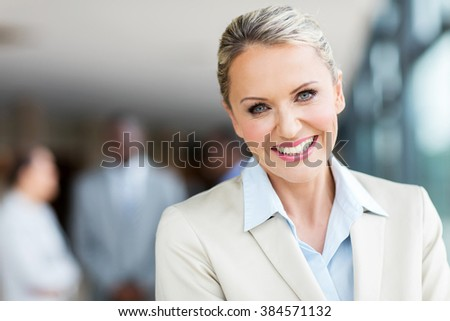 close up portrait of cheerful mid age businesswoman - stock photo