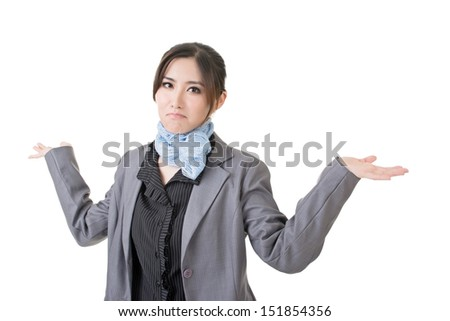 Close-up portrait of cheerful young asian businesswoman shrugging. Isolated on the white background.