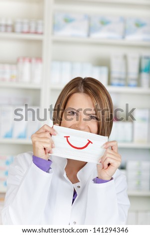 Close up portrait of chemist with smiley draw on paper - stock photo