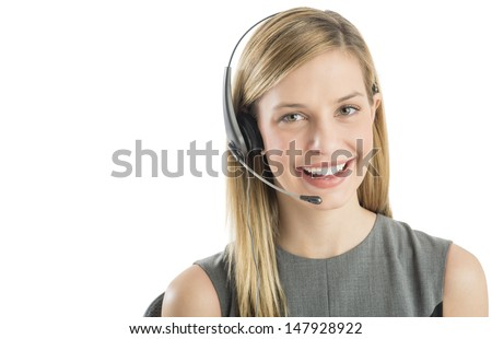 Close-up portrait of confident female customer service representative wearing headset isolated over white background - stock photo