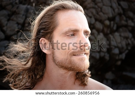 Close up portrait of confident man - stock photo